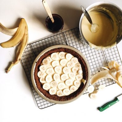 banana cream pie with oatmeal cookie crust recipe by the wood and spoon blog by kate wood. A simple press in crust made up of store bought crunchy crisp oatmeal cookies (i use gmomma's) is filled with a vanilla and banana flavored pastry cream and slices of real bananas. The whole thing is topped with whipped cream and extra banana for garnish. This recipe is a great summer or spring time cream pie recipe and can easily feed a crowd at your next gathering or party. Find the recipe at thewoodandspoon.com