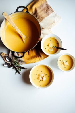 butternut squash soup recipe by the wood and spoon blog by kate wood. this is a creamy fall and winter time soup make from roasted butternut squash, cream, onions or shallots, garlic and savory herbs like thyme, rosemary, and more. This recipe feeds a crowd and is great to make ahead. Find the recipe for this delicious one pot dutch oven broth soup on thewoodandspoon.com