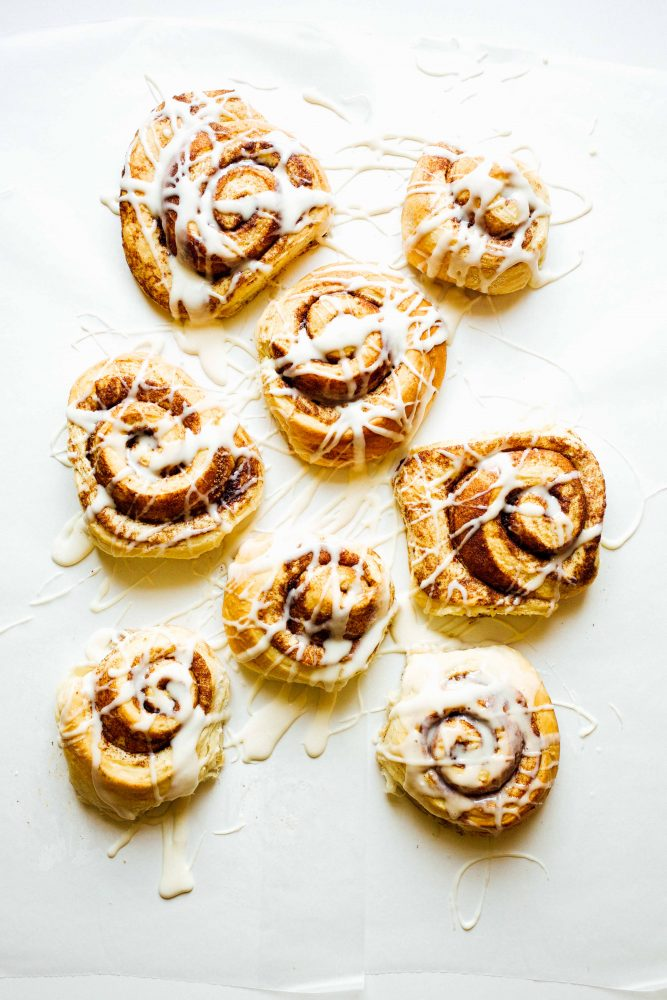 Hazelnut Cinnamon Rolls Recipe by The Wood and Spoon Blog by Kate Wood. A simple yeast dough inspired by The Pioneer Woman Cinnamon Rolls filled with a hazelnut brown sugar and cinnamon crunchy filling. The whole thing is topped with a cream cheese frosting. You can make giant cinnamon rolls or make it into a find cinnamon roll cake in a springform pan. Find the recipe for these fabulous fancy brunch or breakfast menu item at thewoodandspoon.com