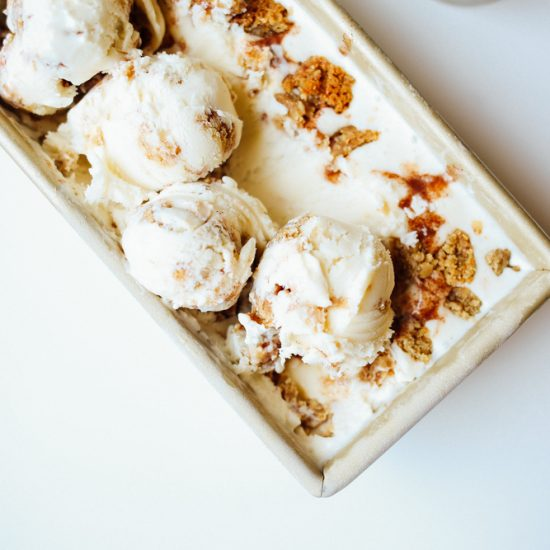 Oatmeal Cookie Chunk Ice Cream Recipe by The Wood and Spoon Blog by Kate Wood. This is a ice cream machine maker recipe inspired by Ben and Jerry's famous oatmeal cookie ice cream. oatmeal infuses the cream and milk mixture and a cinnamon swirl filling and chunks of chewy oatmeal cookies are added to this to make it the best oatmeal cookie filled ice cream ever. Find the simple and fun summer frozen dessert recipe on thewoodandspoon.com