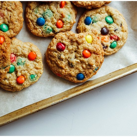 Trail Mix Cookies recipe by The Wood and Spoon Blog by Kate Wood. Fun cookies to make with kids! These trail mix cookies have raisins, chocolate candies (m&M's), peanuts and oats! The cookies have crisp edges and chewy centers and are simple and easy to make. Requires short time and one bowl to make. Trail mix cookies are good summer camp recipe, school recipe, craft idea to bake with kids. Find the recipe on thewoodandspoon.com