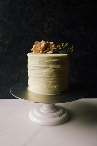 White Chocolate Cake Recipe by The Wood and Spoon Blog by Kate Wood. Adapted from Rose Levy Beranbaum Cake Bible cake. A three layer, fluffy and moist white chocolate vanilla butter cake layers topped with a simple white chocolate cream cheese frosting. This cake is rich and sweet, perfect for special occasions, birthdays, weddings, etc. The golden layers stay fresh and soft for days. Find the Recipe at thewoodandspoon.com