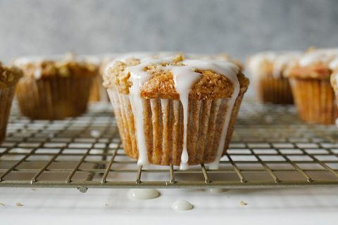 Hummingbird Muffins Recipe by thewoodandspoon.com . Crumb / streusel topped muffins based on the classic Southern hummingbird cake recipe, these muffins are filled with brown butter, banana, pineapple, brown sugar, and nuts. Topped with a simple glaze/ drizzle. This recipe would be perfect for an Easter breakfast or brunch and are a great treat to share with friends. Simple, easy recipe based on Bake From Scratch Coffee Cake. By The Wood and Spoon Blog.