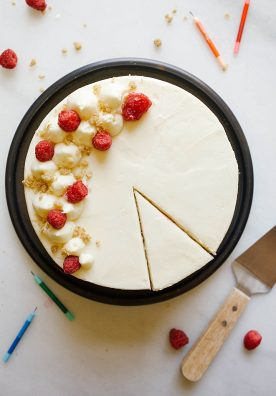 Raspberry Streusel Cake Recipe by The Wood and Spoon Blog. Three layers of brown sugar vanilla cake filled with a quick and simple raspberry compote and sprinkles of cinnamon sugar streusel crumble. The naked cake is coated in a tangy cream cheese frosting. This layer cake can be prepared in parts days in advance and stays moist over time. Find this party cake recipe (perfect for holidays and Mother's Day !) on www.thewoodandspoon.com / woodandspoon.com