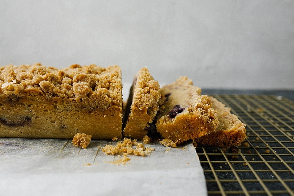 Brown Sugar Pound Cake with Blueberries and Brown Butter Crumb Topping Recipe by The Wood and Spoon Blog by Kate Wood. This recipe makes two loaves of moist southern style pound cake swirled with blueberries and topped with a brown butter brown sugar crumble. This is a simple recipe with many of the elements being make ahead. This is also a great breakfast loaf/ dessert to share with friends because there are two cakes made! Find the recipe on thewoodandspoon.com