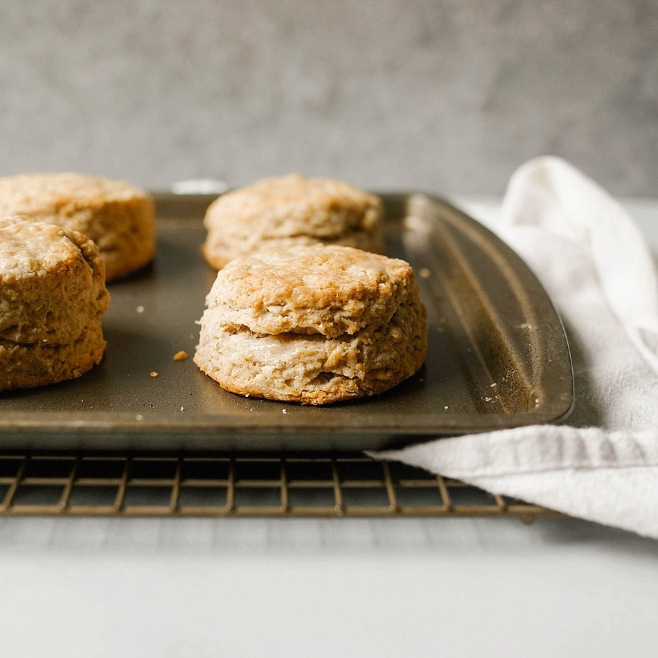 Maple Oatmeal Biscuits Recipe by The Wood and Spoon blog by Kate Wood. This is a simple, one bowl recipe for southern style fluffy layered biscuits filled with rolled oats and pure maple syrup. The biscuits are tall and thick, soft from the addition of buttermilk. Naturally sweet with maple syrup, these are best served for breakfast or as an easy addition to brunch. Find the recipe and the how to on thewoodandspoon.com