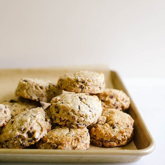 Chocolate Coffee Almond Scones Recipe by The Wood and Spoon Blog by Kate Wood. These are crisp and fluffy scones made with real butter and filled with espresso power, mini chocolate chips, and chopped almonds. These scones are made by cutting butter into the dry ingredients and are flavored with mocha and fresh nuts. Find the recipe and how to on www.thewoodandspoon.com
