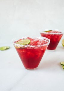 Pinot Ritas and the Saveur Blog Awards Recipe by The Wood and Spoon Blog by Kate Wood. These margaritas are the classic tequila on the rock cocktail sweetened with a pinot noir rice reduction. The simple syrup sweetens the boozy drink and adds some wine notes to it. This beverage is perfect for parties, Mexican dinner nights, or just for one and is served with a salted glass rim and a lime wedge. Find the recipe and read about the Saveur Blog awards in Charleston, South Carolina, on thewoodandspoon.com