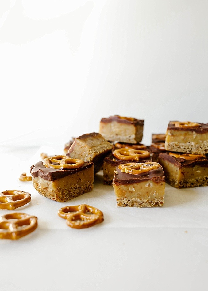 Pretzel Millionaire Bars by The Wood and Spoon Blog by Kate Wood. These are a simple holiday bar recipe prepared with sweetened condensed milk. A buttery pretzel shortbread crust is topped with a homemade gooey caramel sauce and a rich semi-sweet chocolate ganache topping. These bars are quick, sweet and salty, and will feed a crowd. Find the recipe and the how to on thewoodandspoon.com.