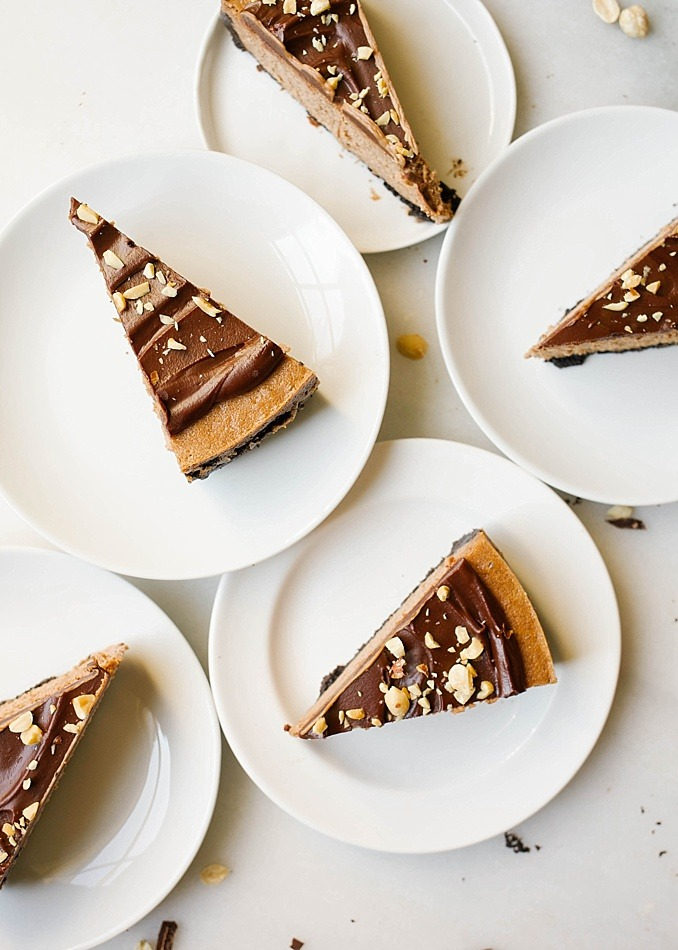 Peanut Butter Chocolate Cheesecake by Kate Wood of The Wood and Spoon Blog. This is a recipe for a cocoa powder and creamy peanut butter cheesecake prepared easily in a Wolf blender. With an Oreo chocolate cookie sandwich crumb crust and a creamy filling, this cheesecake is simple and feeds a crowd. Topped with chopped peanuts and a creamy peanut butter dark chocolate ganache. Find the recipe and the how to as well as a review for the Wolf blender on thewoodandspoon.com