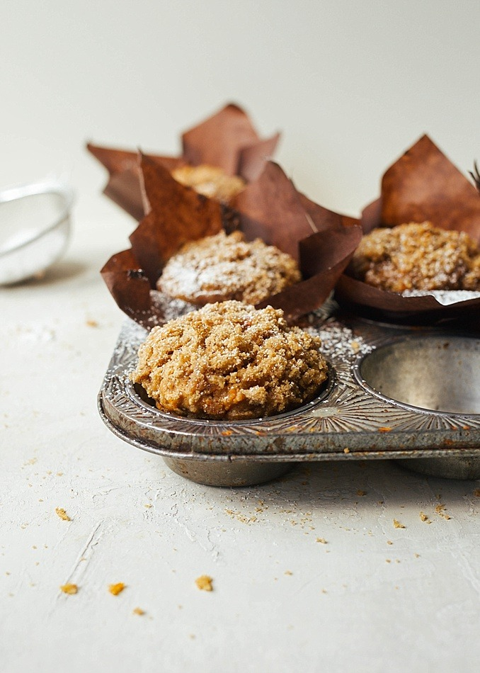 Whole Wheat Carrot Muffins by the Wood and Spoon Blog by Kate Wood. These are healthy, whole grain muffins, sweetened naturally with golden raisins and topped with a simple streusel. The muffins are kept moist with oil and grated carrots and can be made ahead and frozen to be shared later. These better for you breakfast treats are the great way to stay on top of your diet in the new year! Find the recipe and how to on thewoodandspoon.com