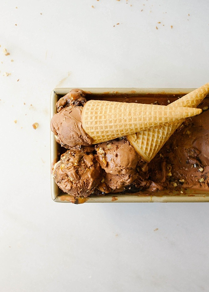 Turtle Ice Cream by The Wood and Spoon Blog by Kate Wood. This is a creamy chocolate ice cream adapted from jenny Britton Bauer, swirled with salted caramel sauce, hot fudge, and toasted pecans. This ice cream is super creamy, rich, sweet and salty. The toasted nuts add crunch that makes this ice cream a simple delicious homemade treat. Find the recipe on thewoodandspoon.com