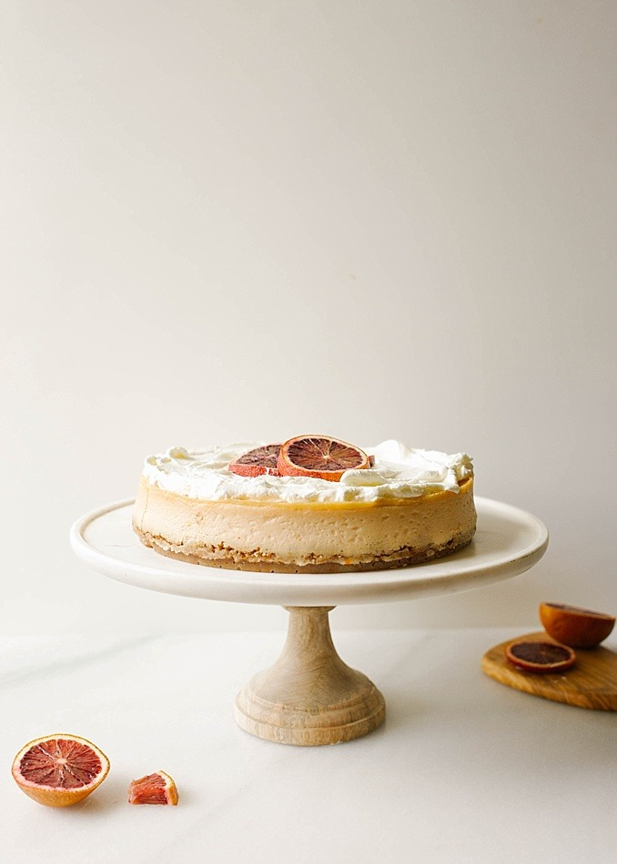 Blood Orange Cheesecake Recipe by The Wood and Spoon blog by Kate Wood. This recipe is for a citrus cheesecake flavored with ruby red blood oranges, The crust is a cinnamon brown sugar and graham cracker crust and the whole thing is topped with a sweet whipped cream topping. The cheesecake, made with cream cheese, is adapted from miette bakery, and has a beautiful pink orange hue due to the oranges! This recipe gives a lot of how-to's on making cheesecakes without crack, bubbles, soggy crust from leaking water bath, etc so check it out on thewoodandspoon.com
