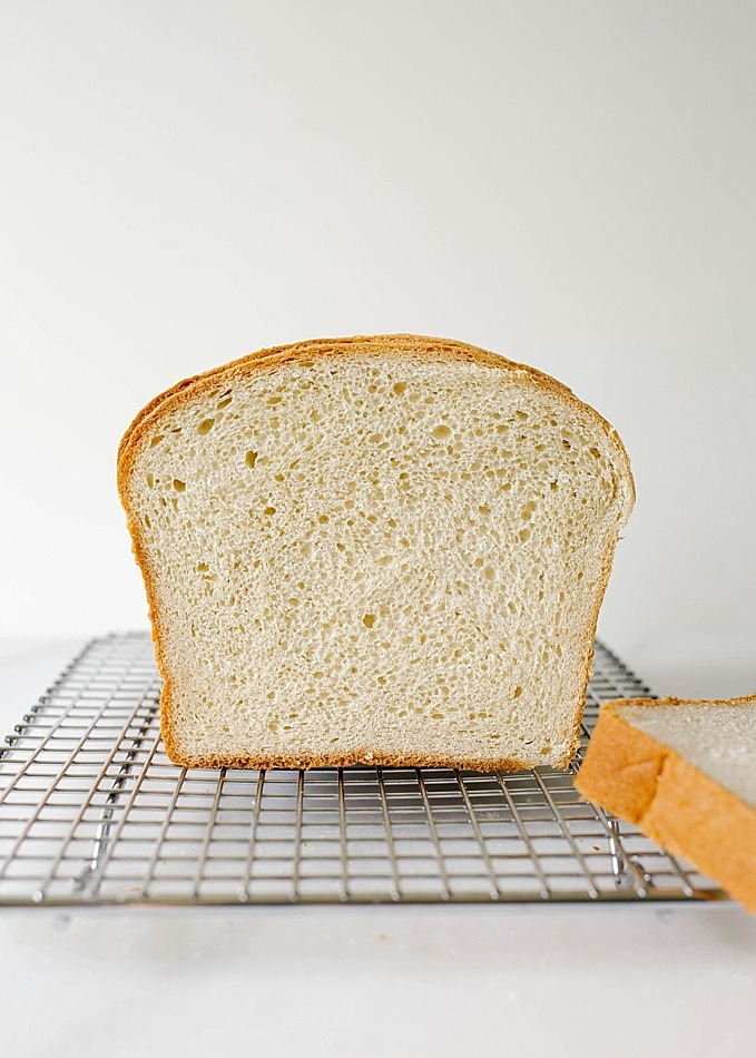 Buttermilk Bread Recipe by Wood and Spoon Blog. This is a fluffy tangy soft homemade bread recipe made without a bread maker. Buttermilk and all-purpose flour make up this mild sandwich bread that is simple for beginners and very few ingredients. You can knead by hand or using a dough hook of a stand mixer. Perfect for deli sandwiches or PB&J. Find the recipe and how to by Kate Wood on thewoodandspoon.com