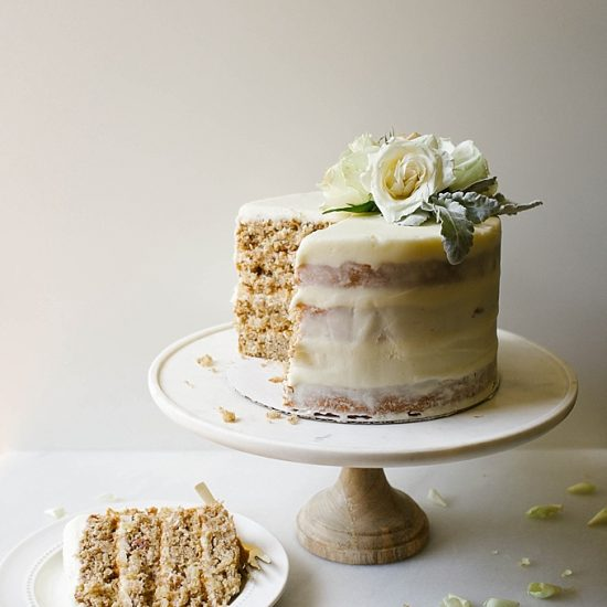 Hummingbird Layer Cake by Wood and Spoon Blog. This is a recipe for a traditional southern pecan, coconut, banana, and pineapple filled cake. The recipe comes from Katie Jacobs' new book So much to celebrate. A cream cheese frosting makes this stacked naked cake sweet and moist. Perfect for summer parties and celebrations. Find the recipe at thewoodandspoon.com