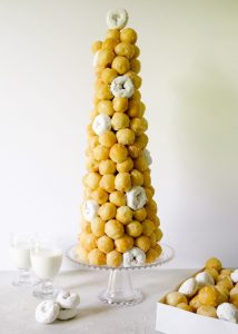 Doughnut Croquembouche Tutorial by Wood and Spoon Blog. Learn how to make the classic French celebration dessert for your upcoming parties and wedding! Just in time for Bastille day, this DIY will show you how to shortcut your way to a donut tower using store-bought treats, a styrofoam cone, and lots fo toothpicks. This is a fancy impressive dessert for parties, brunches, and everything in between. Find out the how-to on thewoodandspoon.com by Kate Wood