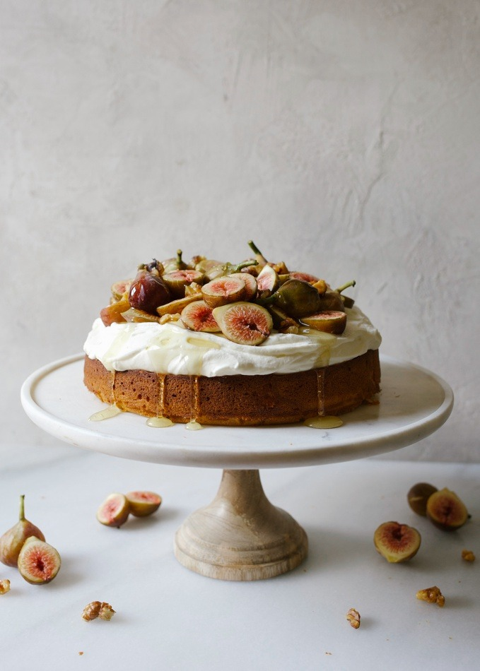 Honey Cake with Figs and Whipped Cream Cheese by Wood and Spoon. This is a single layer round honey cake topped with a cream cheese flavored stable whipped cream, fresh figs and candied Diamond walnuts. An extra drizzle of honey rounds out this simple yet elegant summer and fall recipe. Enjoy this seasonal treat recipe by Kate Wood on thewoodandspoon.com