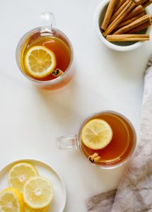 Sweet Tea Hot Toddy recipe by Wood and spoon blog. This is a bourbon, lemon, cinnamon and honey cocktail sweetened with pre made red diamond sweet tea. A southern take on the classic cocktail. Serve it warm for a refreshingly cozy holiday winter beverage. Make for a crowd for parties too! Read more at thewoodandspoon.com