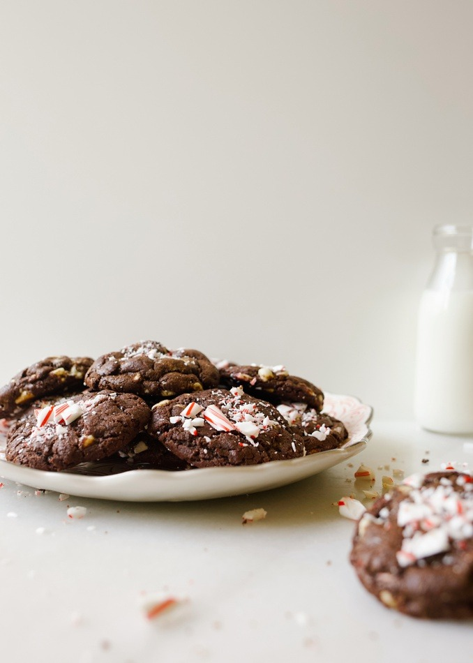 Chocolate Peppermint Olive Oil Cookies by Wood and Spoon blog. These are chewy chocolate cookies with bits of candy cane throughout! Using Lucini olive oil instead of butter, these cookies are chewy, soft, and tender, and have loads of delicious holiday flavor. Learn more about these simple treats on thewoodandspoon.com and try them out this Christmas at your holiday gift exchange!