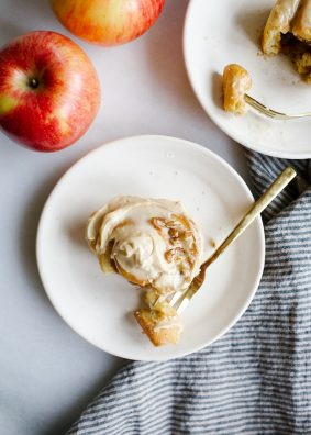 Apple Cinnamon Rolls by Wood and Spoon blog. These are simple morning rolls filled with brown sugar, cinnamon, and crisp Stemilt apples. On top, an Irish cream liquor cream cheese frosting gives the buns a sweetened and flavorful topping. Garnish with nuts! These pastries can be made overnight and baked fresh in the morning quickly and you can substitute in another fruit for apples! Find the st Patricks day breakfast treat on thewoodandspoon.com by Kate Wood