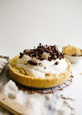 Banoffee Pie recipe by wood and spoon blog. This is a salted graham cracker and brown sugar crust filled with gooey sliced banana and a thick and rich toffee filling made with sweetened condensed milk. Whipped cream tops the pie along with chocolate shavings. This is a sweet and salty dessert for a crowd based on the traditional British favorite. Read more about this treat sponsored by kerrygold butter on thewoodandspoon.com