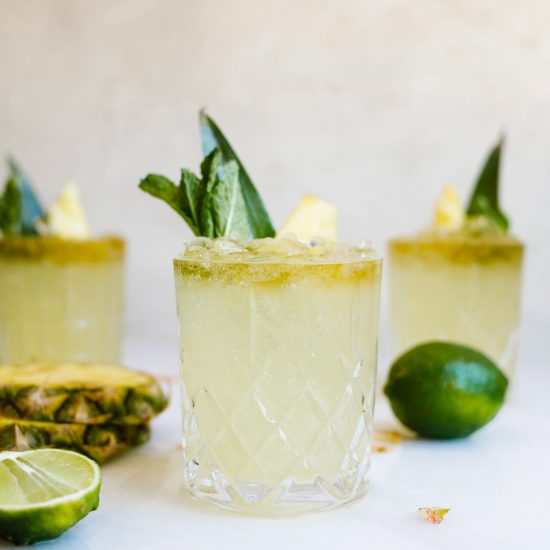 Mai Tai Margaritas by Wood and Spoon. The rum based island cocktail meets Mexican margarita flavors with pineapple, lime, orange, almond, and agave to flavor it. This makes a great summer beach cocktail perfect for Lounging poolside with. Make a boozy treat for friends on a summer day or just in time for cinco de mayo! Find the recipe and how to on thewoodandspoon.com by Kate wood.