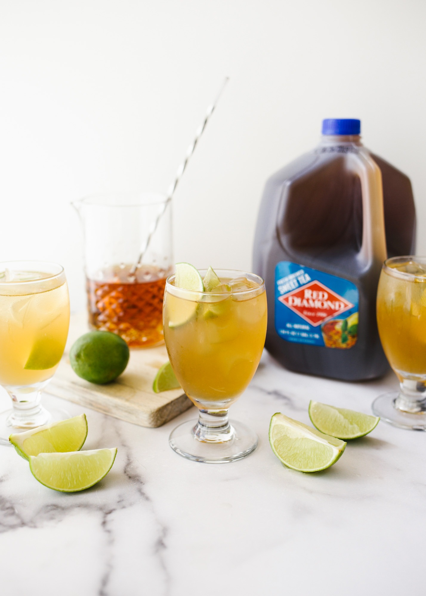 Bourbon Ginger Sweet Tea made with ginger beer, bourbon whiskey, lime, and Red Diamond ready-to-drink sweet tea. This is a great summertime cocktail that can be batched for a crowd. Refreshing from the ginger and sweetened by Read Diamond's tea, this bourbon cocktail is a Southern delight! Learn more about the recipe on thewoodandspoon.com