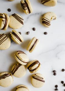 Mocha Macarons by Wood and spoon. Theres are coffee espresso flavored French macaron shells filled with a rich semisweet chocolate ganache scented with coffee! Learn how to make these elegant delicate fancy cookies on thewoodandspoon.com by Kate Wood
