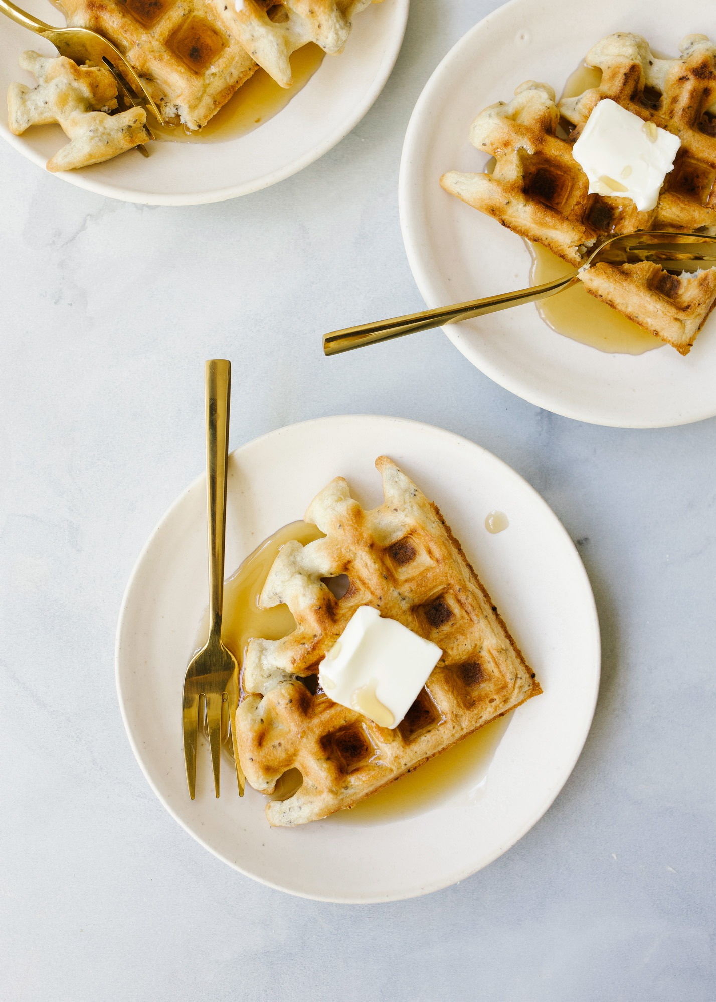 Family Waffle by Wood and Spoon blog. This recipe from Sarah Copeland book Everyday is Saturday is a healthy dairy free waffle made with quinoa and chia seed. This makes 4 thick Belgian style waffles and is best served with maple syrup or a healthy portion of fresh fruit and yogurt. Read more about these make ahead and reheat breakfast treats on thewoodandspoon.com