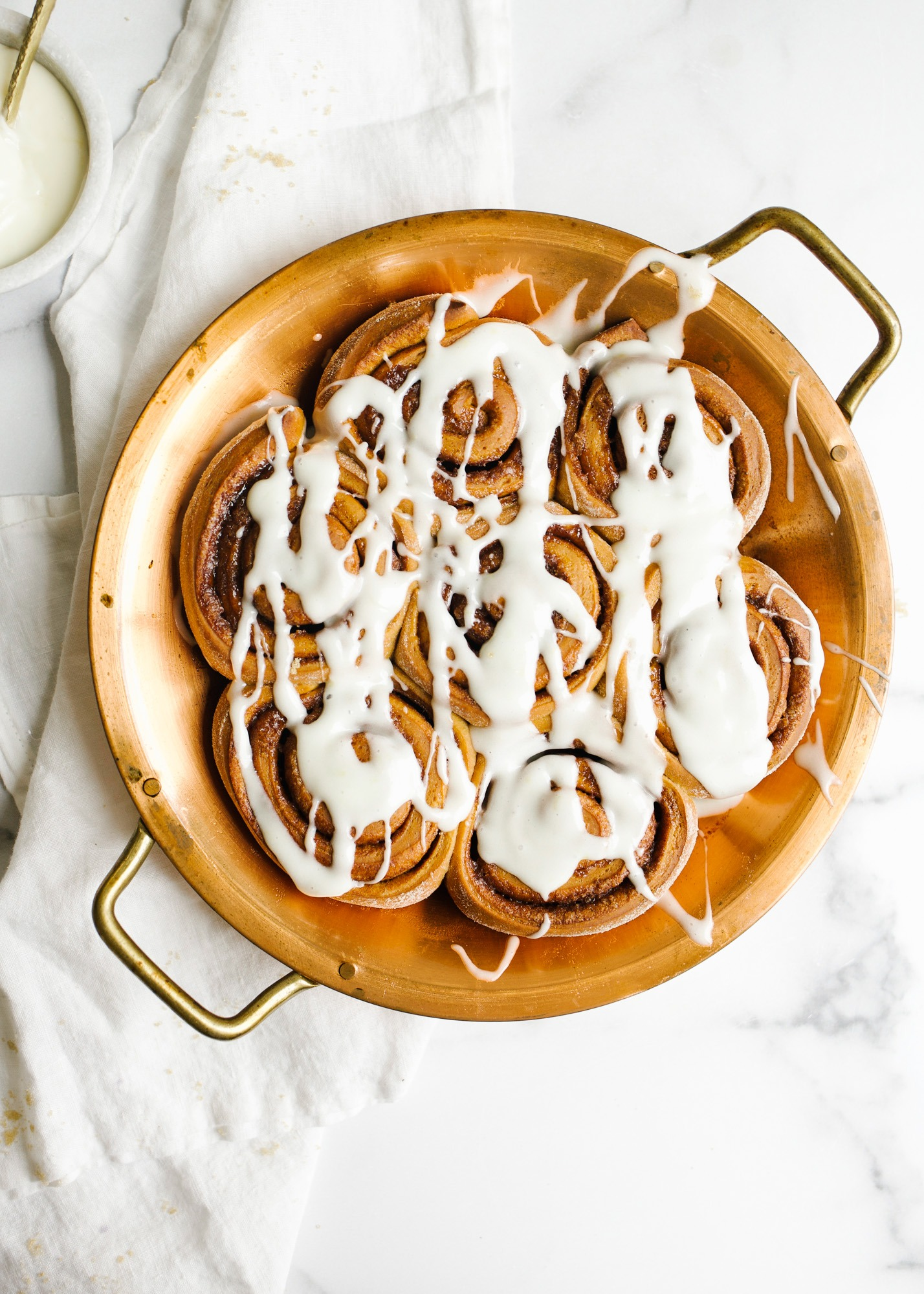 Gingerbread Cinnamon Rolls by Wood and Spoon. This recipe is for holiday spiced morning buns filled with cinnamon, ginger, nutmeg, and other Christmas cookie spices. The recipe can be prepped overnight and made in advance and the whole thing has a tangy lemon cream cheese icing that can be frosted on the fluffy giant rolls. Learn how to roll the cookies and find out more about this recipe on thewoodandspoon.com by Kate Wood.