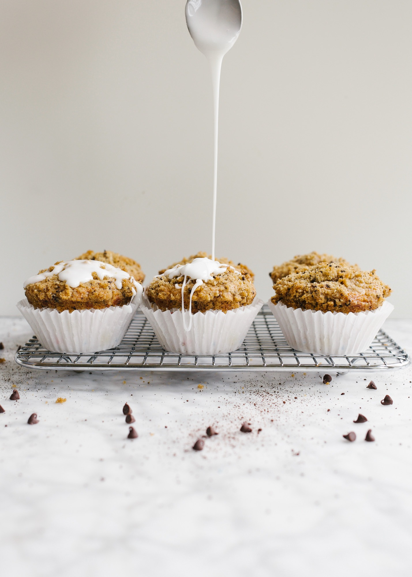 Java Chip Muffins by Wood and Spoon blog. These are fluffy, one-bowl muffins scented with coffee and dotted with mini chocolate chips. The muffins have a simple brown sugar streusel crumble that has espresso powder and adds a bit of sweet to the muffins. These taste terrific with morning coffee and are a simple make ahead breakfast or brunch treat. Learn more about this easy family recipe on thewoodandspoon.com