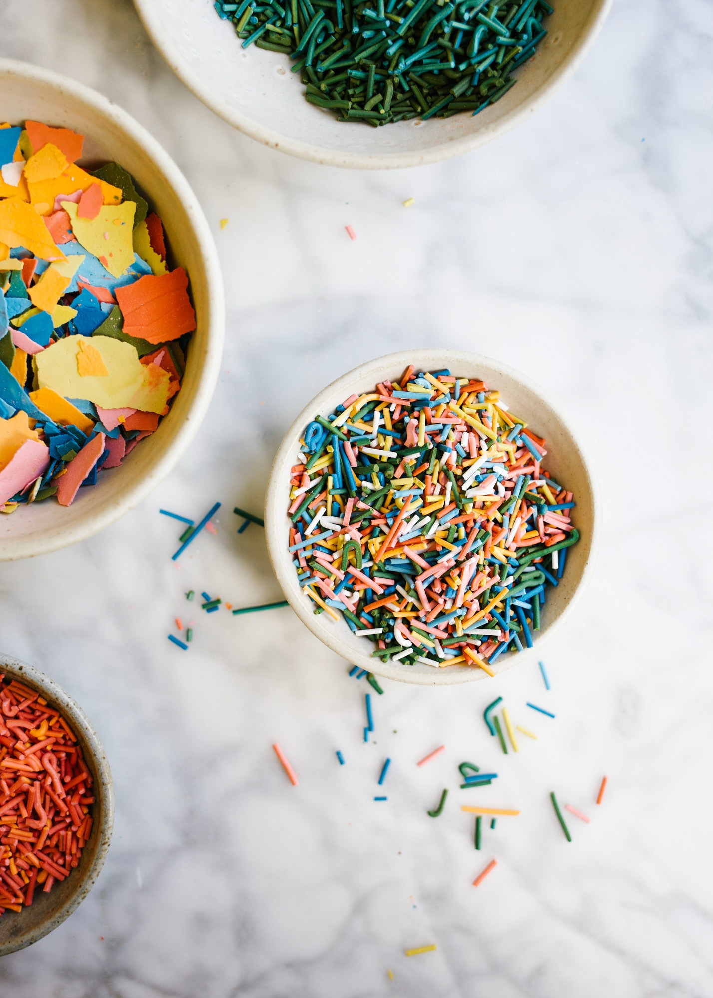 Homemade Sprinkles by Wood and Spoon blog. Here's the how to on making sprinkles from scratch! Follow one of three ways to make hand-dyed jimmies, nonpareils, and flaked sugar confetti. Use these edible decorations to glitter cakes, cookies, cupcakes and more! Find the recipes and learn DIY from scratch here on thewoodandspoon.com