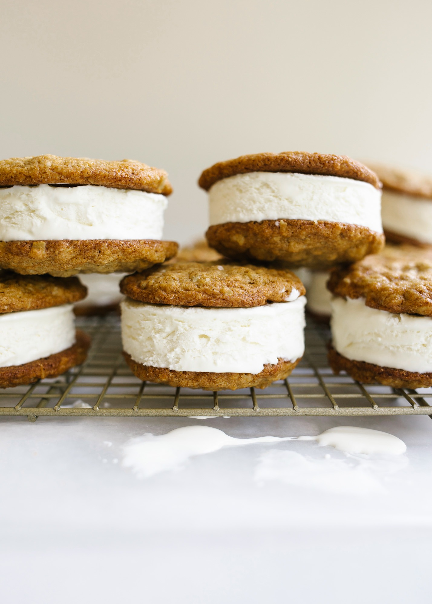 Oatmeal Cream Pie Ice Cream Sandwiches by Wood and Spoon blog. These are a frozen version of the traditional store bought cookie sandwiches made with chewy thin oatmeal cookies and filled with a no-churn marshmallow ice cream. The ice cream comes together with three ingredients including marshmallow fluff and the cookies stay soft even when frozen! Learn more about this treat and how to make homemade frozen ice cream sandwiches on thewoodandspoon.com