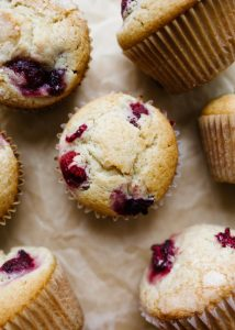 Raspberry Muffins by Wood and Spoon blog. These are fluffy, soft, maple syrup-sweetened muffins loaded with fresh raspberries or berries of your choice. The muffin uses butter for flavor, oil for moisture, and loads of complex and sweet syrup for sweetening. Add an extra layer of sugar for a crisp, caramelized top and enjoy these breakfast pastries all day long. Favorite morning sweets on thewoodandspoon.com