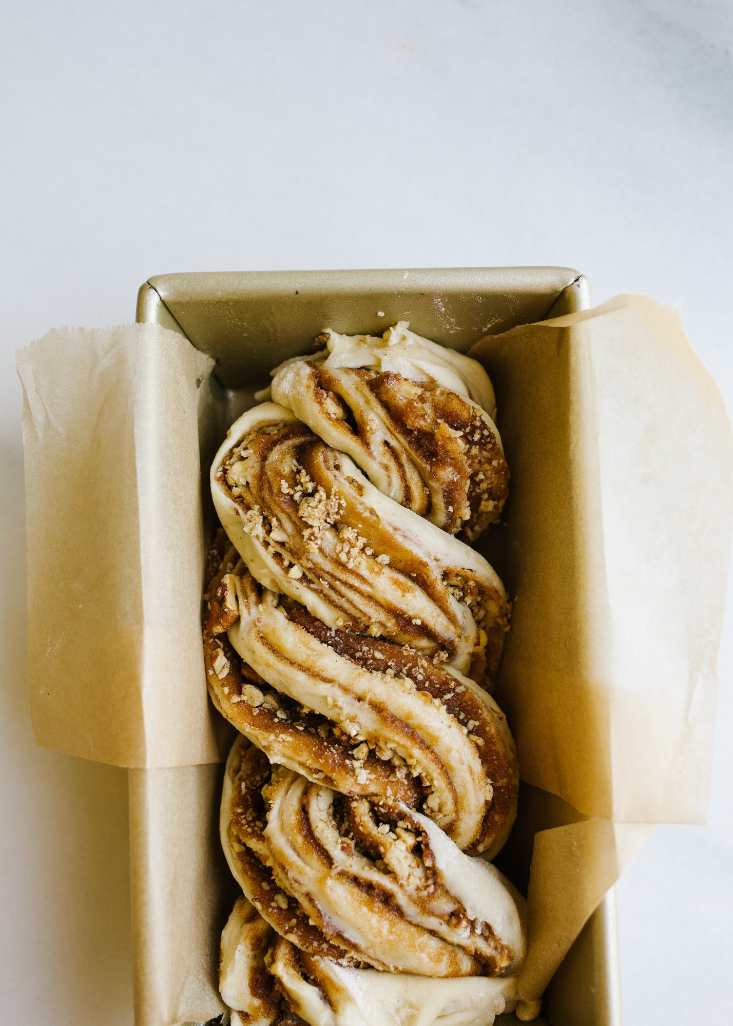 Pecan Babka by Wood and Spoon blog. This is a light and fluffy cinnamon swirl bread filled with brown sugar, cinnamon, and pecans! The loaves are tender, buttery, and lightly sweetened, and this bread makes for an excellent dessert or breakfast treat! Learn how to make it and braid your own babka on thewoodandspoon.com
