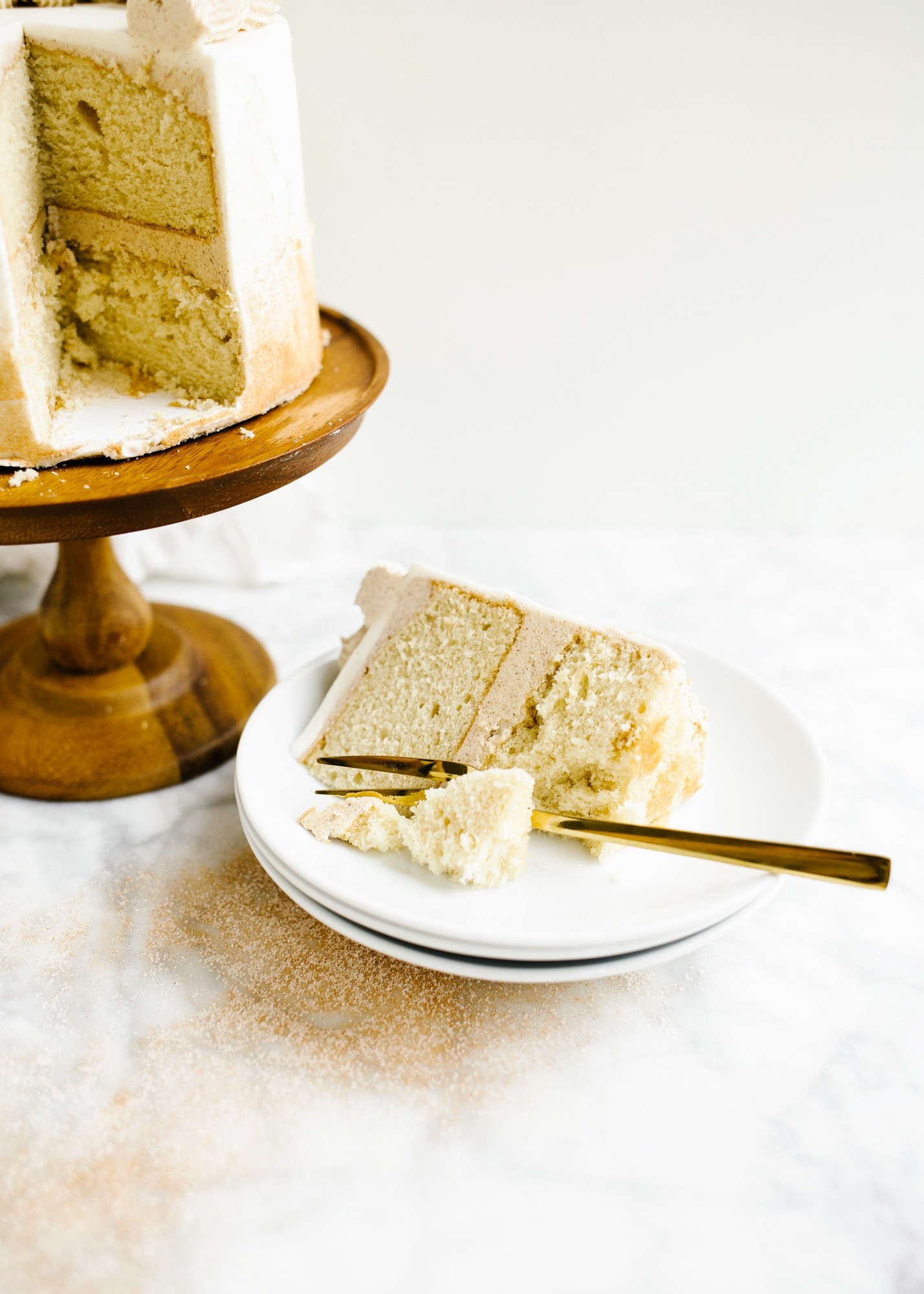 Cinnamon Sugar Cake by Wood and Spoon blog. This is a fluffy brown sugar cake with a salted cinnamon brown sugar filling and vanilla bean frosting. This spiced dessert is perfect for fall birthday parties or holiday gatherings or anyone who loves good cozy flavors. Learn more about this cake on thewoodandspoon.com