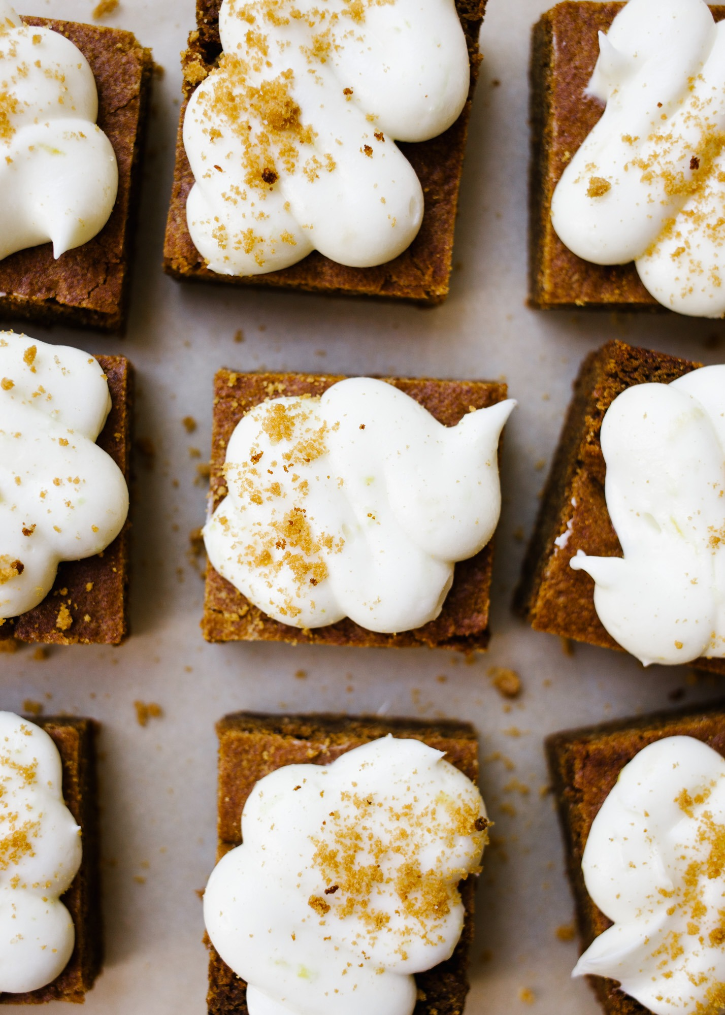 Chewy Gingerbread Lemon Barsrs by Wood and Spoon. These are soft blondie-like bars flavored with ginger and topped with a cream cheese and lemon frosting! These bars and sweetened and chewy, perfect for the holidays! Learn how to make these sweet gingerbread treats on thewoodandspoon.com