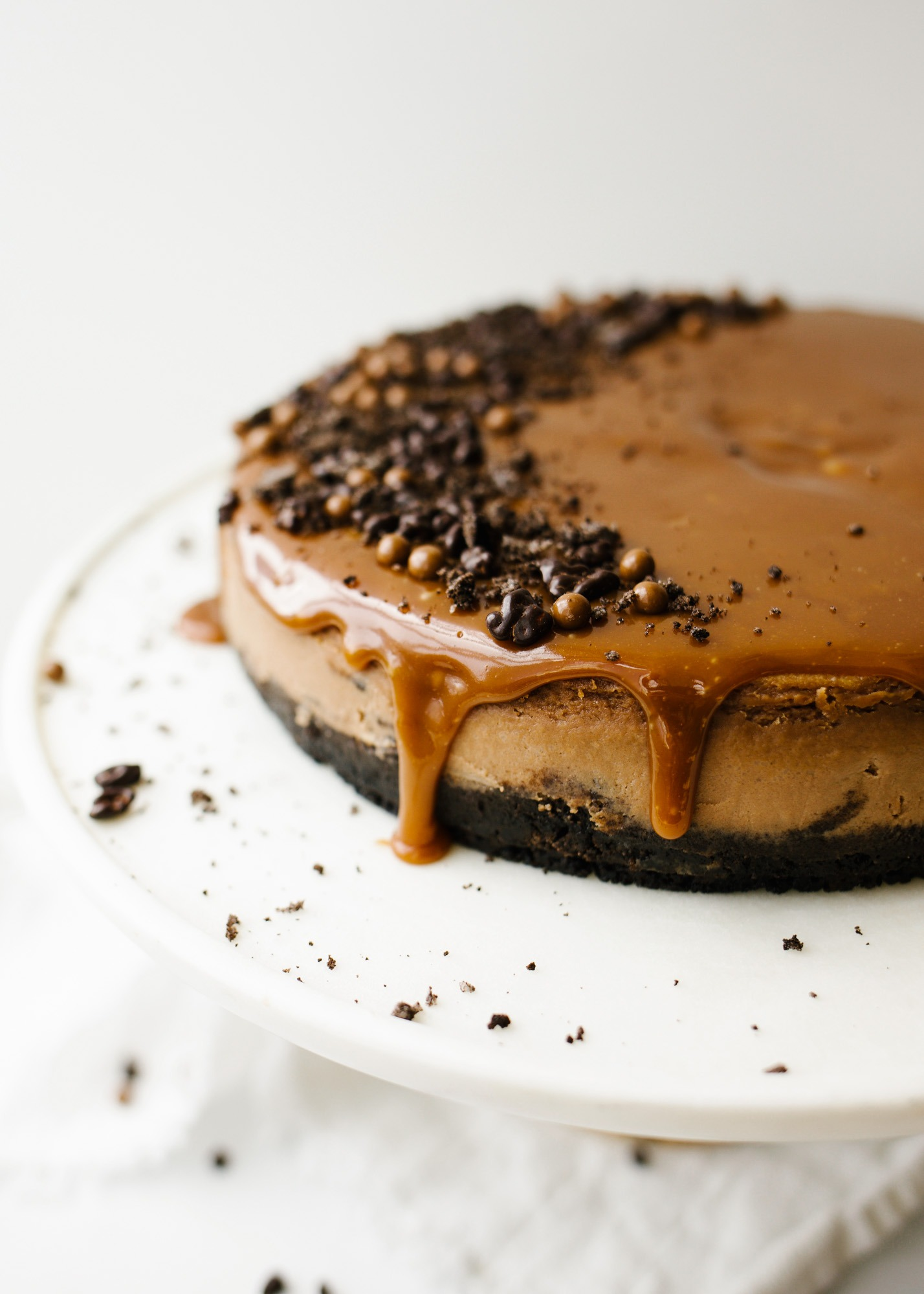 Chocolate Mascarpone Cheese by Wood and Spoon blog. This is a creamy chocolate cheesecake made with mascarpone cheese, a chocolate sandwich cookie Oreo crust, and a rich caramel topping. The crust is scented with espresso powder and lends a buttery crunch to the otherwise smooth dessert. This is a decadent treat for chocolate lovers and a great alternative to a cream cheese cheesecake. Learn how to make it on thewoodandspoon.com