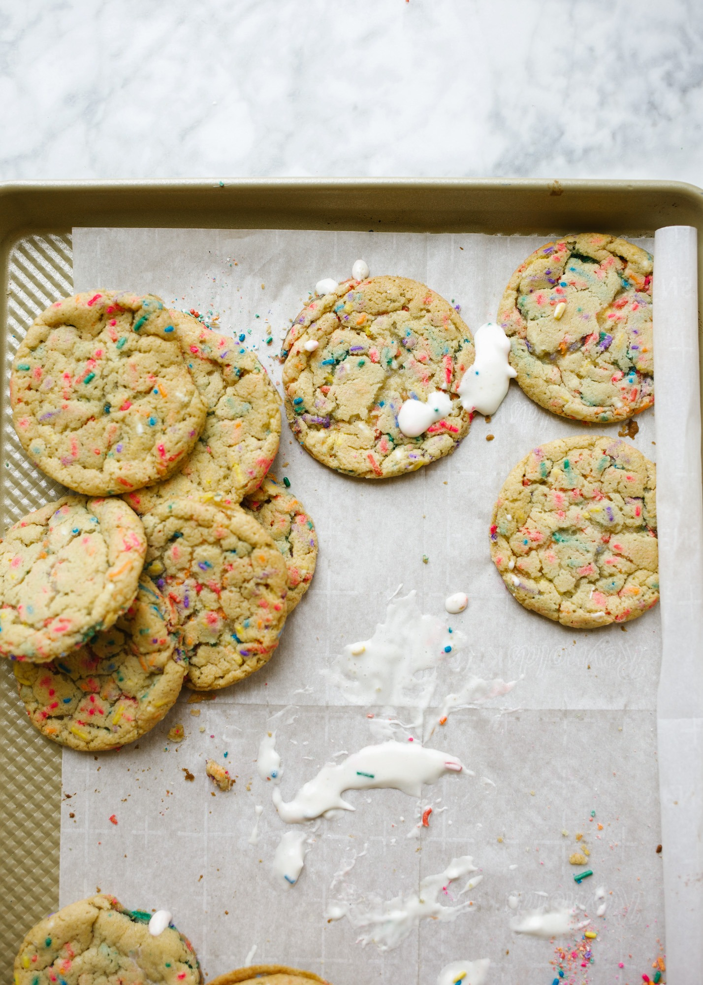 Funfetti Ice Cream Sandwiches by Wood and Spoon blog. These are soft and chewy sugar cookies loaded with sprinkles and box cake mix flavor. These nostalgic treats are stuffed with a no-churn ice birthday cake ice cream and make terrific summertime treats. Learn how simple these frozen desserts are on thewoodandspoon.com
