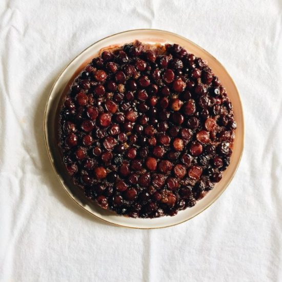 concord grape upside down cake recipe by the wood and spoon blog by kate wood. This is a buttery golden single layer cake made with juicy seedless concord grapes. The cake gets baked in the oven and gooey pieces of fruit keep the cake moist for days. This is a great cake to eat for breakfast or dessert or tea time. Make this cake in a springform pan. Find the recipe and how to roast grapes on thewoodandspoon.com