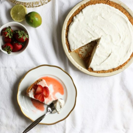 vegan coconut lime ice cream pie This is a vegan coconut ice cream recipe made in a machine with lime zest and sweetened with sugar. It's frozen inside a press-in graham cracker crust and the whole thing is topped with a strawberry lime compote. This pie is refreshing and delicious, perfect for the special diet vegan/ vegetarian friends in your life. Find the recipe for this berry lime icebox pie on thewoodandspoon.com