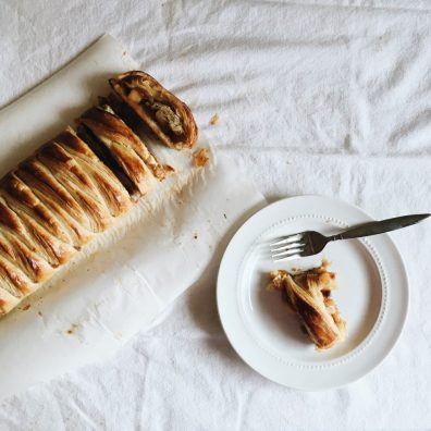 breakfast danish by the wood and spoon blog by kate wood. This is a rough puff pastry made by laminating dough, rolled out and filled with winter fruits like apples, cherries, cranberries, and other bourbon soaked fruit. Learn how to make laminated dough and how to braid a danish dough. Turns into golden, flaky, pastry once baked. Recipe at thewoodandspoon.com