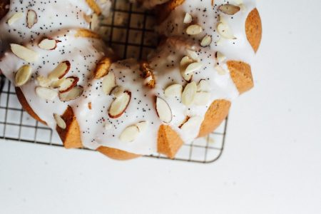 Lemon Almond Poppyseed Bundt Cake Recipe Recipe by the wood and spoon blog by kate wood. This is a simple, fluffy, golden and white almond cake speckled with poppyseed and lemon zest and juice. The cake is spongy and perfect for breakfast or dessert. The whole thing is topped with a simple sugar glaze icing and slivered almonds. Find this springtime bundt cake recipe on thewoodandspoon.com.