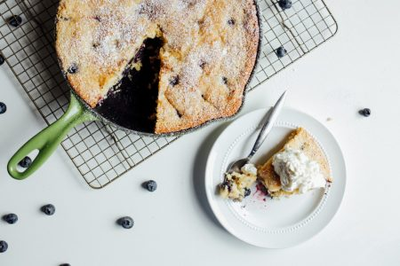 Blueberry Cornbread Recipe by The Wood and Spoon Blog by Kate Wood. This is a cornmeal and flour skillet cake made with fresh blueberries and sugar. A simple, one bowl cake recipe made in a cast iron skillet, speckled with summer berries and sprinkled with powdered sugar. You can serve this with honey butter or whipped cream as dessert, or eat thick slices of it for breakfast. Find the recipe at thewoodandspoon.com