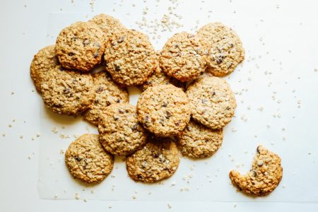 Loaded Oatmeal Cookies Recipe by The Wood and Spoon Blog by Kate Wood. These are simple stuffed oatmeal cookies loaded with your choice of ingredients. Chunky oats, chocolate chips. dried fruits like raisins and cranberries, or even candies, toffee, or nuts! These oatmeal cookies are simple to make, buttery, and full of brown sugar goodness. You can freeze as well! Find the recipe on thewoodandspoon.com
