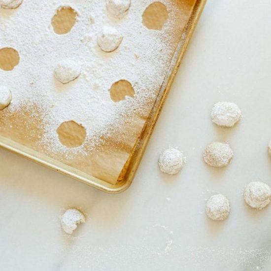 Lemon Lavender Cookies Recipe by The Wood and Spoon Blog by Kate Wood. Just a few ingredients, lemon zest, sugar, and dried culinary lavender is all it takes to make this simple powdered sugar covered cookies. Similar to mexican wedding cookies. Makes tiny mini cookies. Floral and fragrant. Find the recipe at thewoodandspoon.com