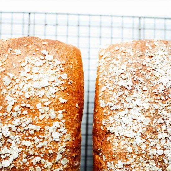 Honey Oat Bread Recipe by The Wood and Spoon Blog by Kate Wood. This is a simple, delicious, and healthy homemade sandwich bread that is sweetened with honey and has old fashioned or quick oats in there. It's a soft, white, chewy bread that makes two loaves. Find the recipe for this simple yeast bread on thewoodandspoon.com