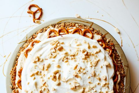 Peanut Butter Pie Recipe By The Wood and Spoon Blog. This is a simple make ahead dessert recipe inspired by Paula Deen's Mrs. Salter's pie. This is a cream cream cheese and whipped cream peanut butter filling topped with salted salty caramel and chopped peanuts. The whole thing is stuffed in a brown sugar, butter, and pretzel pie crust. This recipe takes less than 30 minutes and is a great treat to make for a dinner party or casual gathering. Find the recipe at thewoodandspoon.com