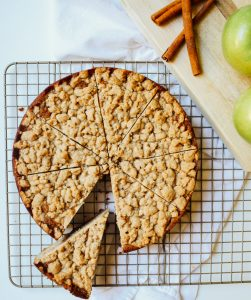Apple Crumb Cake Recipe by The Wood and Spoon Blog by Kate Wood. This is a fun and simple way to use apples or pears or other fall produce. A simple fluffy cake recipe sweetened with applesauce and chunks of peeled apples. The topping is a crumble streusel that adds a bit of crunch to every bite. This cake is a great breakfast coffee cake or dessert to share with friends. Find the recipe at thewoodandspoon.com