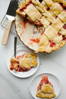 Strawberry Rhubarb Pie Recipe by The Wood and Spoon Blog. Tart rhubarb, sweet berries and a touch of cinnamon make this the perfect pie. Post includes information on how to use and trim rhubarb, tips on preparing the perfect flaky butter pie crust, and other spring pie inspiration. Can be made with a decorative or lattice braid pie top. thewoodandspoon.com